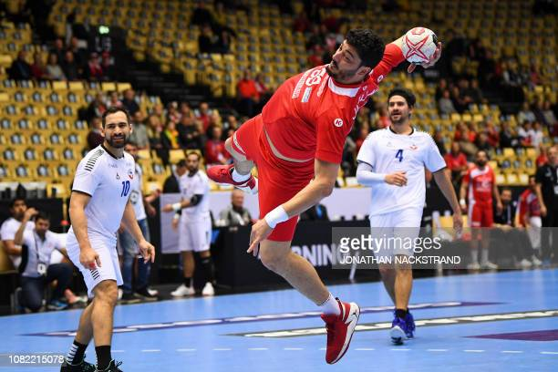 Tunisia's Jihed Jaballah prepares to throw the ball during the IHF Men's World Championship 2019 Group C handball match between Tunisia and Chile at...