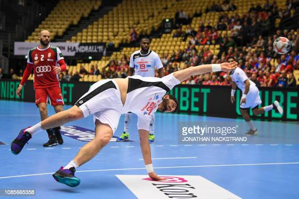 Tunisia's Jihed Jaballah throws the ball during the IHF Men's World Championship 2019 Group II handball match between Hungary and Tunisia at the...