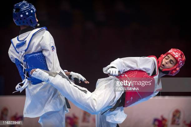 Tunisia's Khazami Yassine and Ethiopia's Tariku Girma compete in the Taekwondo men's 58kg 63 kg final during the 12th edition of the African Games on...
