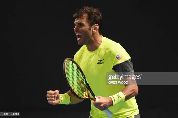 Tunisia's Malek Jaziri celebrates after victory over Italy's Salvatore Caruso in their men's singles first round match on day one of the Australian...
