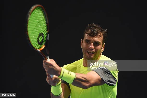 Tunisia's Malek Jaziri plays a forehand return to Italy's Salvatore Caruso during their men's singles first round match on day one of the Australian...