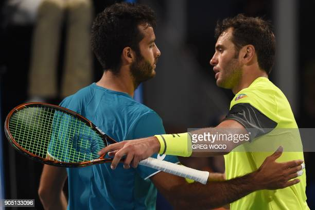 Tunisia's Malek Jaziri shakes hands as he celebrates after victory over Italy's Salvatore Caruso in their men's singles first round match on day one...