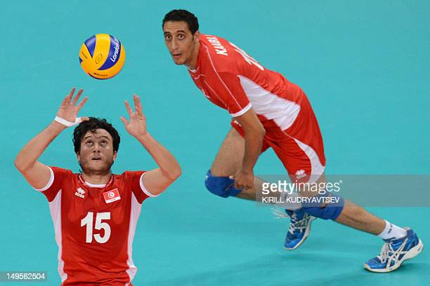 Tunisia's Mehdi Ben Cheikh sets up the ball during the men's preliminary pool B volleyball match between Serbia and Tunisia in the 2012 London...