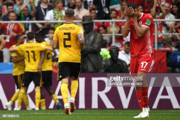 Tunisia's midfielder Ellyes Skhiri covers his face as Belgium's players celebrate their fifth goal during the Russia 2018 World Cup Group G football...