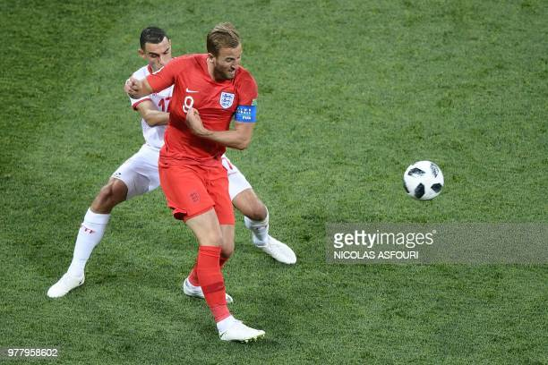 TOPSHOT Tunisia's midfielder Ellyes Skhiri vies for the ball with England's forward Harry Kane during the Russia 2018 World Cup Group G football...