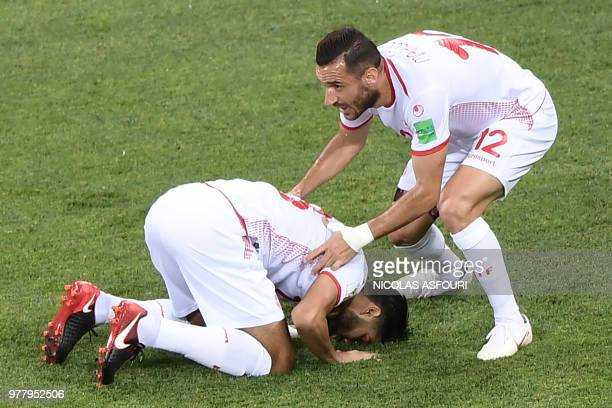 Tunisia's midfielder Ferjani Sassi celebrates after scoring a penalty kick during the Russia 2018 World Cup Group G football match between Tunisia...