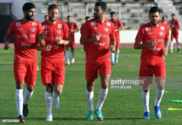 Tunisia's midfielder Ferjani Sassi forward Fakhreddine Ben Youssef defender Yassine Meriah and midfielder Mohamed Amine Ben Amor take part in a...