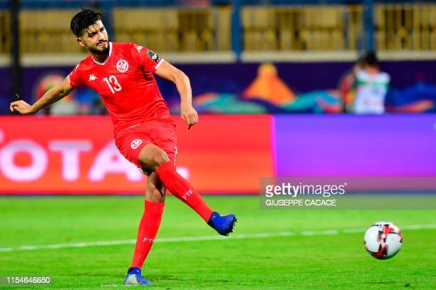 Tunisia's midfielder Ferjani Sassi scores a penalty during the 2019 Africa Cup of Nations Round of 16 football match between Ghana and Tunisia at the...