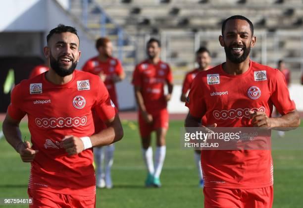 Tunisia's midfielder Ghailene Chaalali and forward Saber Khalifa take part in a training session at the Olympic stadium El Menzah in the Tunisian...