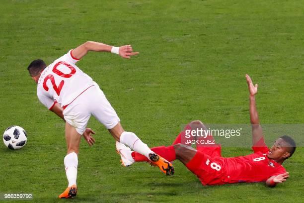 Tunisia's midfielder Ghailene Chaalali fights for the ball with Panama's midfielder Edgar Barcenas during the Russia 2018 World Cup Group G football...