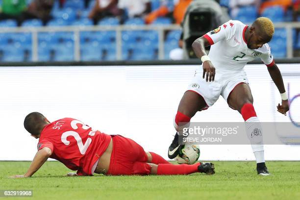 Tunisia's midfielder Naim Sliti challenges Burkina Faso's defender Steeve Yago during the 2017 Africa Cup of Nations quarterfinal football match...