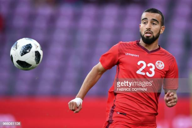 Tunisia's midfielder Naim Sliti eyes the ball during a football match between Tunisia and Turkey at the Stade de Geneve stadium in Geneva on June 1...