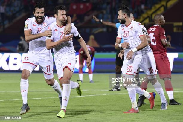 Tunisia's midfielder Youssef Msakni celebrates after scoring a goal during the 2019 Africa Cup of Nations quarter final football match between...