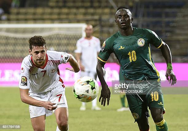Tunisia's midfielder Youssef Msakni challenges Senegal's forward Sadio Mane during the 2017 Africa Cup of Nations group B football match between...