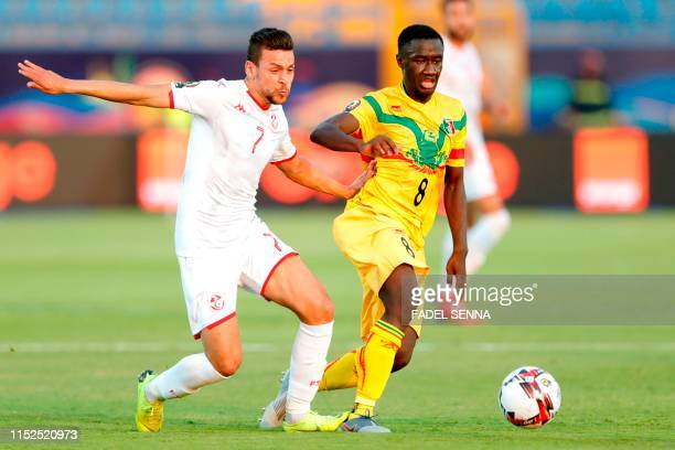Tunisia's midfielder Youssef Msakni vies for the ball with Mali's midfielder Diadie Samassekou during the 2019 Africa Cup of Nations Group E football...