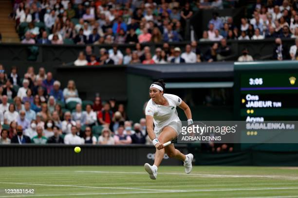 Tunisia's Ons Jabeur returns against Belarus's Aryna Sabalenka during their women's quarter-final tennis match on the eighth day of the 2021...