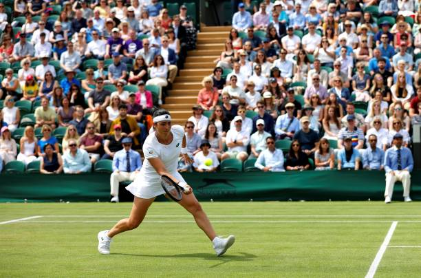 Tunisia's Ons Jabeur returns against Poland's Iga Swiatek during their women's singles fourth round match on the seventh day of the 2021 Wimbledon...