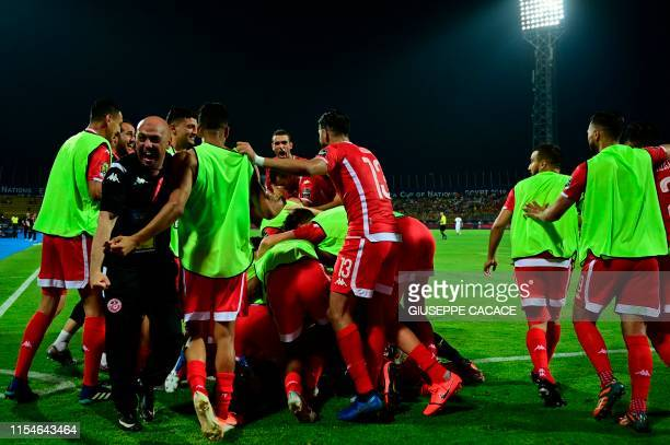 Tunisia's players celebrate their goal during the 2019 Africa Cup of Nations Round of 16 football match between Ghana and Tunisia at the Ismailia...