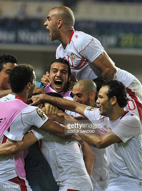 Tunisia's players celebrate their team's second goal during the Africa Cup of Nations 2012 Group C football match between Tunisia and Morocco at the...