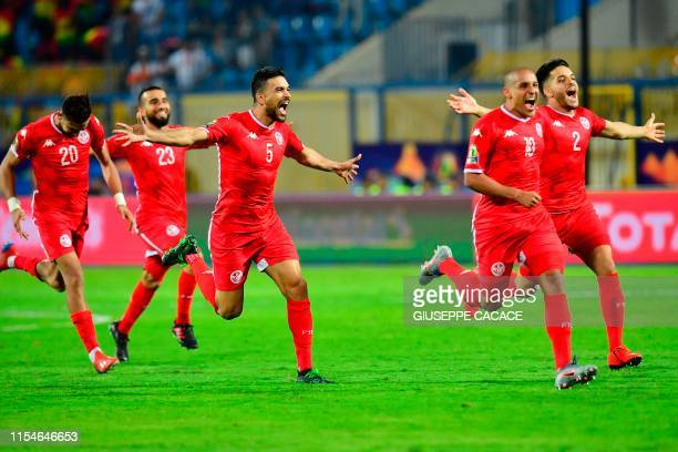 Tunisia's players celebrate their win during the 2019 Africa Cup of Nations Round of 16 football match between Ghana and Tunisia at the Ismailia...