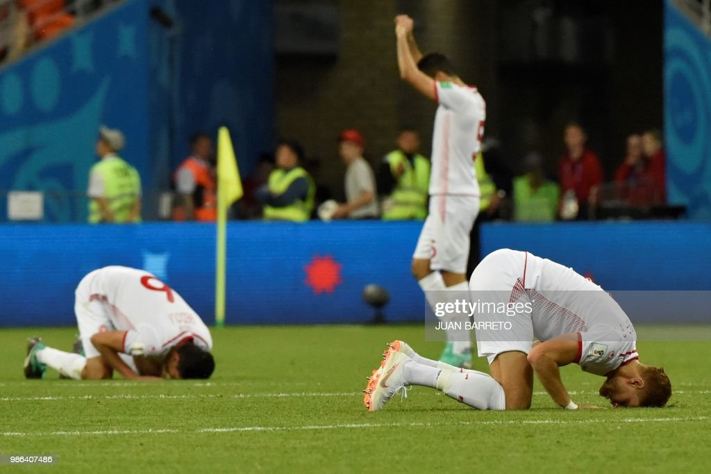 TOPSHOT - Tunisia's players react at the end of the Russia 2018 World Cup Group G football match between Panama and Tunisia at the Mordovia Arena in Saransk on June 28, 2018. (Photo by JUAN BARRETO / AFP) / RESTRICTED
