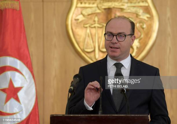 Tunisia's prime ministerdesignate Elyes Fakhfakh addresses the media during a press conference in the capital Tunis on January 24 2019 The former...