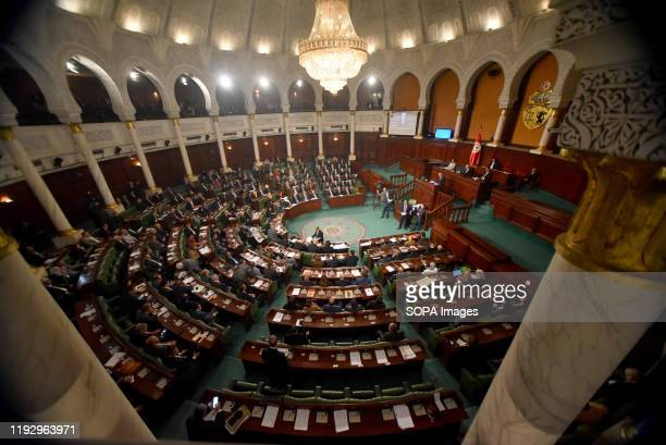Tunisia's Prime Ministerdesignate Habib Jemli addresses parliamentarians during a parliament plenary session for a confidence vote on a proposed...