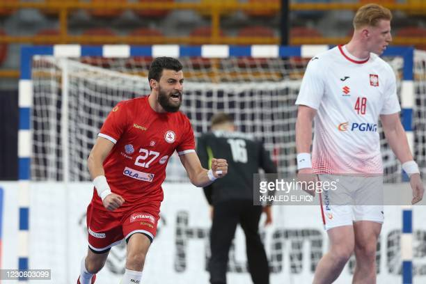 Tunisia's right winger Issam Rzig celebrates a goal during the 2021 World Men's Handball Championship match between Group B teams Tunisia and Poland...