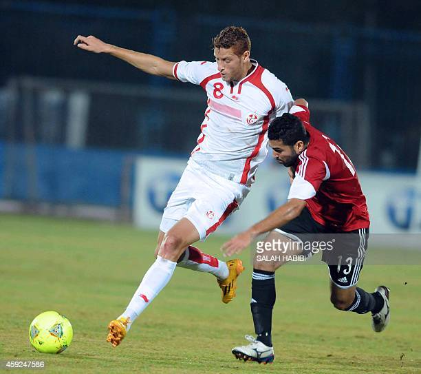 Tunisia's striker Fakhreddine Ben Youssef vies with Egyptian defender Ahmed Almohamdi during the 2015 Africa Cup of Nations qualifying football match...