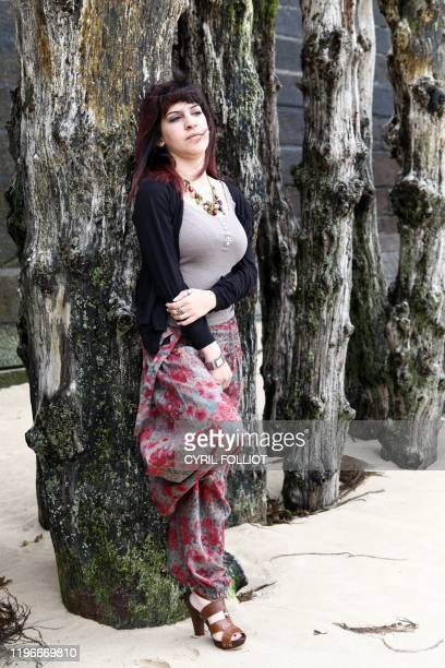 Tunisia's writer and blogger Lina Ben Mhenni poses on June 12 2011 in SaintMalo Brittany western France during the 22nd edition of the literature...
