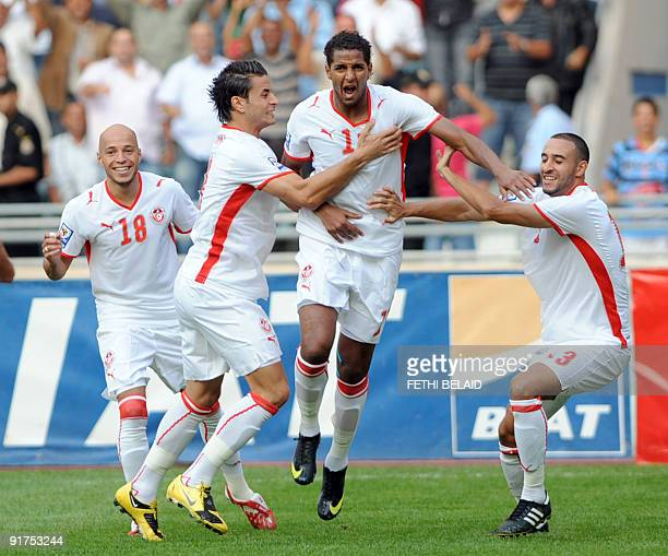 Tunisia's Yassine Mikari Khaled Korbi Issam Jomaa and Nabil Tayder celebrate after scoring against Kenya during their 2010 World CupAfrican Nations...