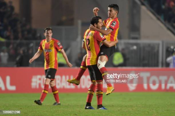 ES Tunis's forward Saad Beguir celebrates after scoring a goal with ES Tunis' defender Khalil Chamam during the CAF Champions League second leg final...