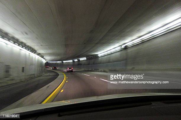 tunnel drive - highway 405 stock photos and pictures