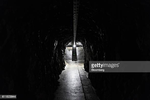 A tunnel leads to a vault inside the Swiss Data Safe AG formermilitary bunker secure storage facility in Amsteg Switzerland on Thursday Aug 5 2016...