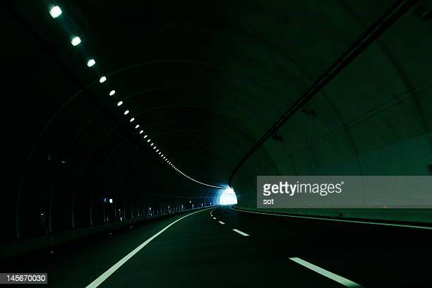 tunnel of expressway - light at the end of the tunnel stock pictures, royalty-free photos & images
