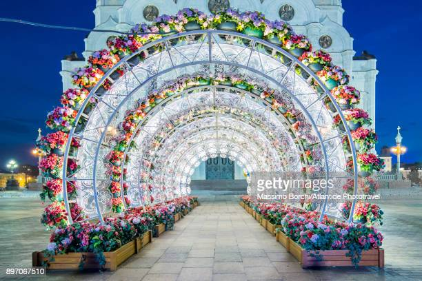 tunnel of lights with flower decorations - arch stock pictures, royalty-free photos & images