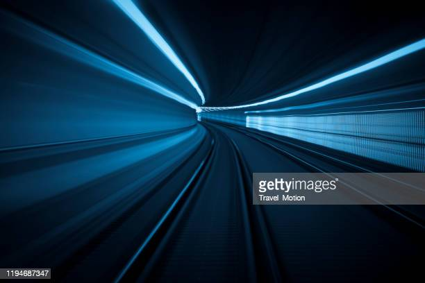 tunnel speed motion light trails - dark blue stock pictures, royalty-free photos & images