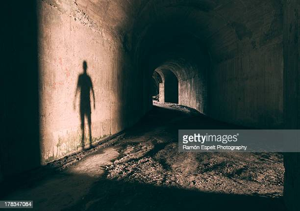 Tunnel with a shadow in the wall