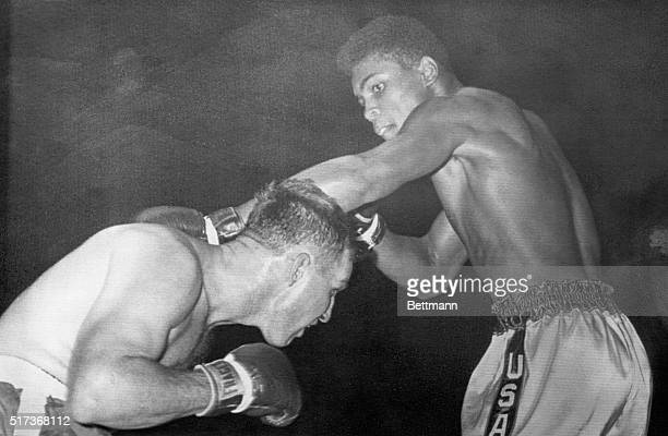 Tunney Hunsaker ducks a strong left by Olympic champion Cassius Clay here in a six-round bout at Freedom Hall. Clay, who was making his professional...
