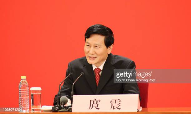 Tuo Zhen, the spokesperson of the 19th National Congress of the Communist Party of China, speaks to the media at the Gold Hall of the Great Hall of...