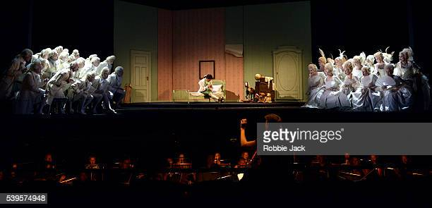 Tuomas Katajala as Ernesto with artists of the company in Gaetano Donizetti's Don Pasquale directed by Mariame Clement and conducted by Duncan Ward...