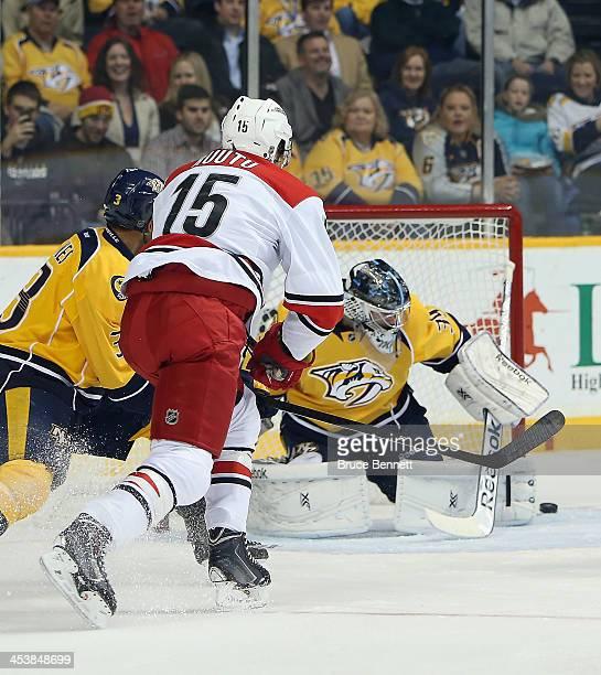 Tuomo Ruutu of the Carolina Hurricanes misses the shot against Marek Mazanec of the Nashville Predators first period at the Bridgestone Arena on...