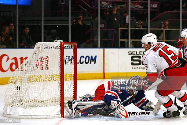 Tuomo Ruutu of the Carolina Hurricanes scores a goal against Henrik Lundvist of the New York Rangers in the first period on October 29 2010 at...