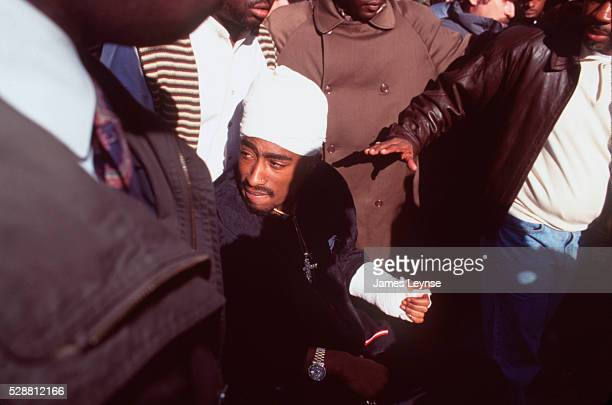 Tupac Shakur leaves a New York City courtroom after a hearing in his sodomy case