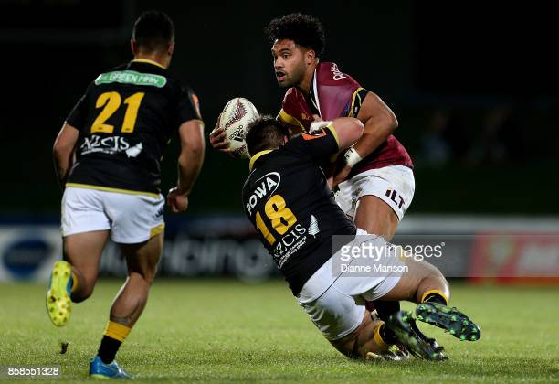 Tupou Sopoaga of Southland is tackled by Haamea Ahio of Wellington during the round eight Mitre 10 Cup match between Southland and Wellington at...