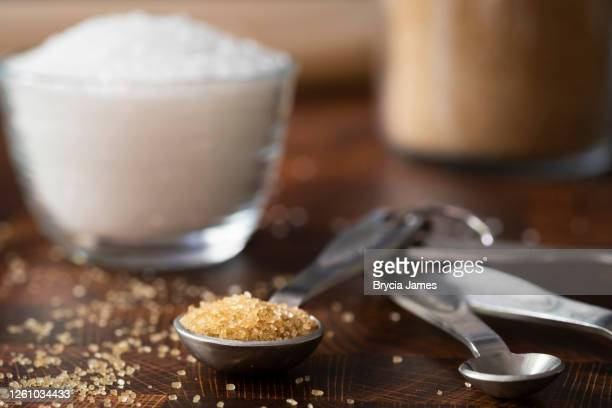 turbinado sugar on a teaspoon - brycia james stock pictures, royalty-free photos & images