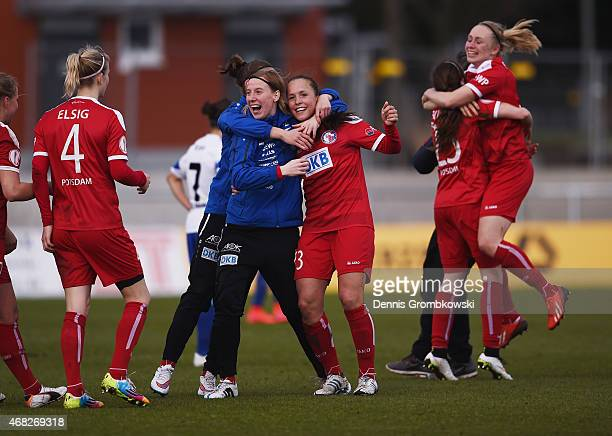 Turbine Potsdam players celebrate after the Women's DFB Cup Semi Final match between 1 FFC Frankfurt and Turbine Potsdam at Stadion am Brentanobad on...