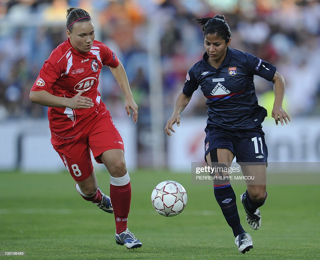 FFC Turbine Potsdam's defender Josephine Henning (L) vies with Olympique Lyonnais's Costa Rican midfielder Shirley Cruz Trana during their Final women's Champions League football match at Coliseum Alfonso Pérez on May 20, 2010 in Getafe.