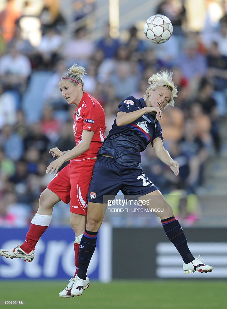 FFC Turbine Potsdam's forward Anja Mittag (L) vies with Olympique Lyonnais' Swedish defender Amelie Rybeck during their Final women's Champions League football match at Coliseum Alfonso Pérez on May 20, 2010 in Getafe.