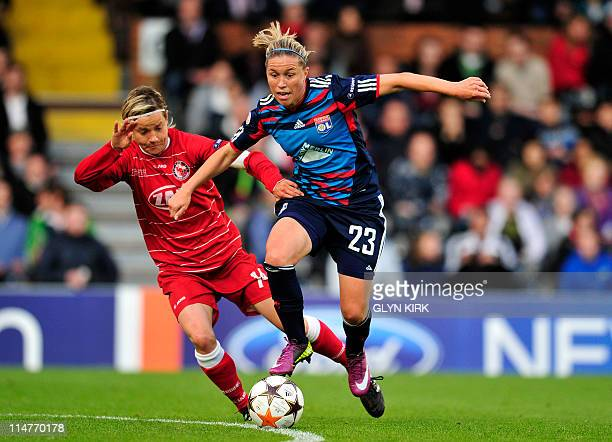 FFC Turbine Potsdam's German midfielder Jennifer Zietz vies with Olympique Lyonnais' French midfielder Camile Abily during their UEFA women's...